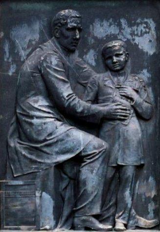 bronze de Braille com um aluno
