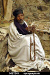 Blind monk praying with beads [Ethiopia] Sean Sprague