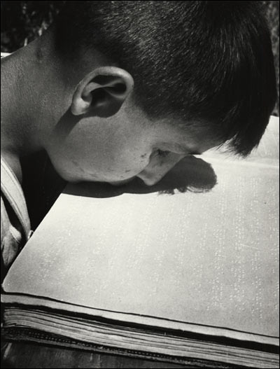 Blind boy reading with his lips - David Seymor, 1948