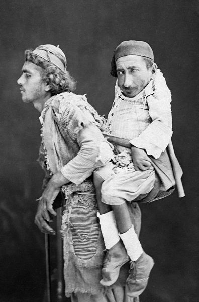 Blind man carrying a paralysed man, Siria 1889