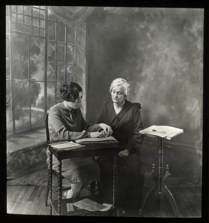 Home lesson in touch reading being given by a blind Teacher, 1926